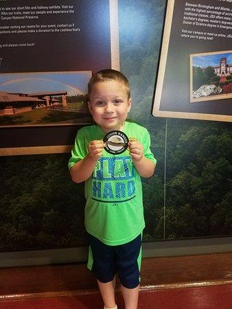 Little River Canyon Center: Taking the Junior Ranger Oath w/ badge @ center