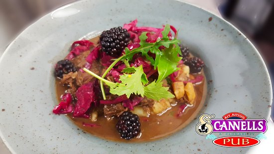 Venison stew with root vegetables, blackberries, pickled red cabbage and creamy mash.