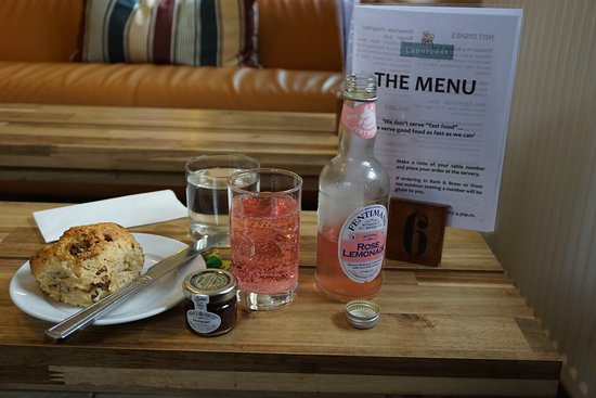 Lanercost, UK: my scone and lemonade, we were lucky to get a sofa