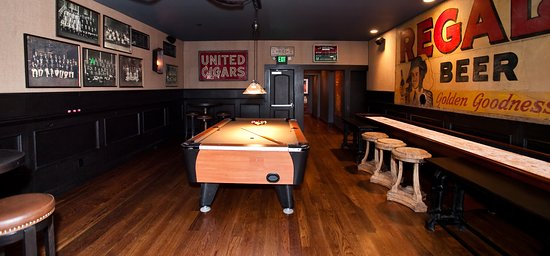 Game room with a tv, pool table, and shuffle board  - Picture of