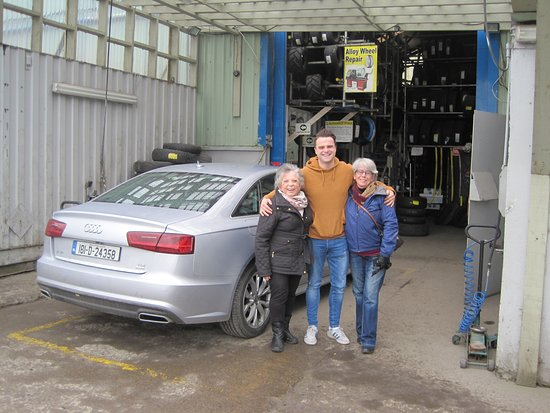 Straffan, Ireland: Helping us get a new tire for our rental car