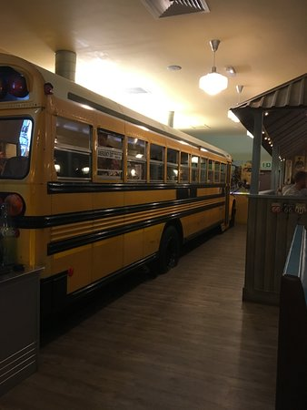 yellow school bus which has seating inside picture of billy bob s