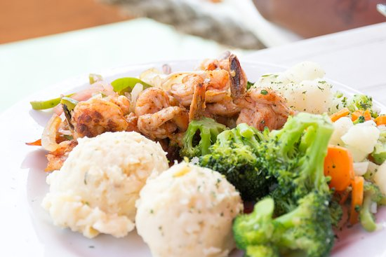 Bird's Isle: Shrimp dish with vegetables.