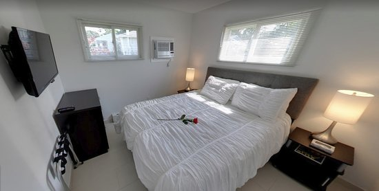 A room with Queen Size Bed