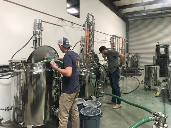 Young & Yonder Spirits: Distillers Shane and Josh mashing some Stave Robber bourbon
