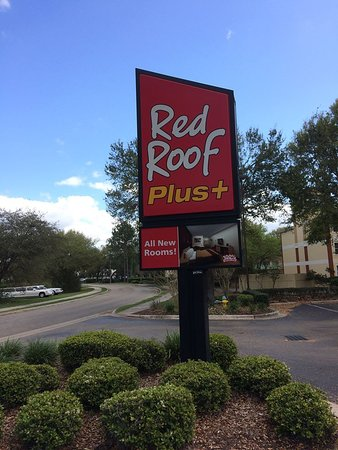 sign near the street picture of red roof plus. Black Bedroom Furniture Sets. Home Design Ideas