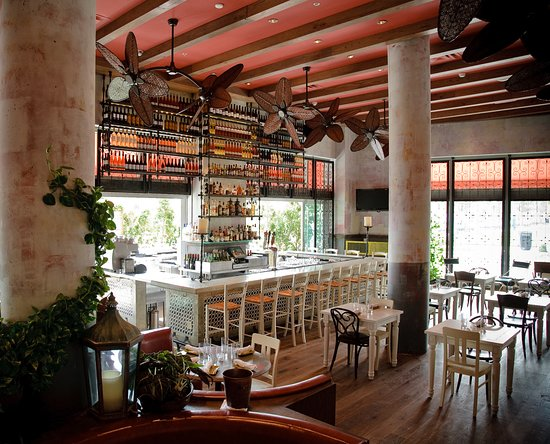 The indoor-outdoor bar at SUGARCANE raw bar grill in ...