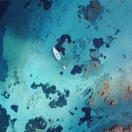 "Palau, Italia: Rumbera Charter - ""Natural Swimming Pool"" area drone view"