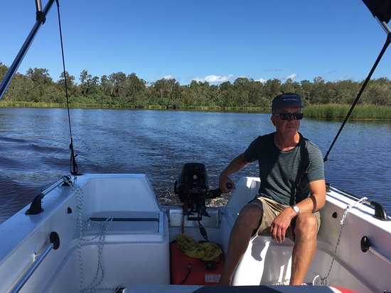 Boreen Point, Australia: Customer at the helm of our hire runabout, such a beautiful day to explore the Noosa Everglades