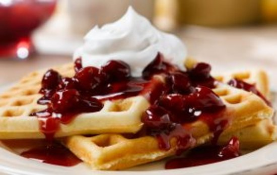 Cascade, ID: Waffles topped with strawberries & whipped cream, Egg Stratas, Pastries, etc.