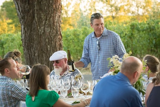 Newberg, OR: Owner, Paul de Lancellotti pours for guests at annual Prima Cena dinner