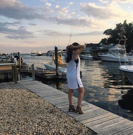 This is a picture of my daughter standing on the beautiful pier/backyard area at the Drake Inn