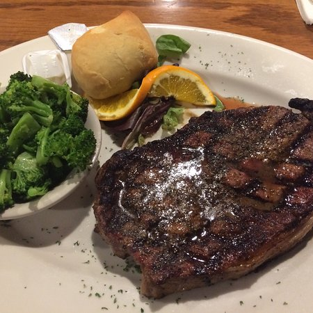 Priceville, AL: Large rib eye cooked medium rare with steamed broccoli