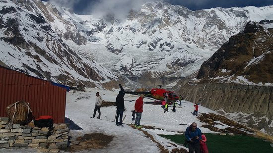 Four Brothers Adventure Travel: heli tour to Abc