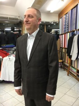 Tito Fashion: smilly face with well fitted suit