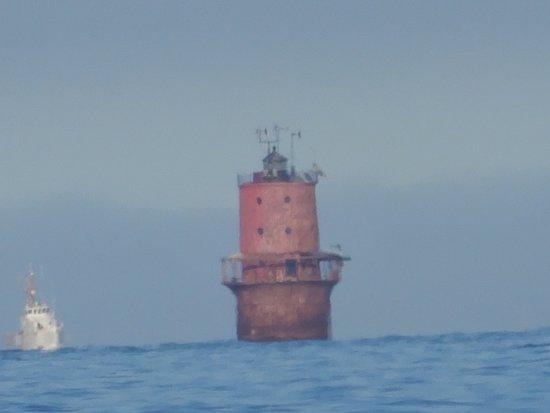 Hampton, VA: Lighthouse with coast guard ship approaching.
