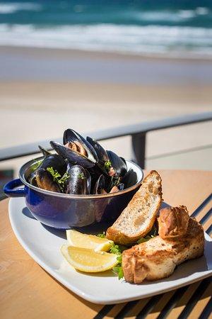 Coolum Beach, Australia: A surf club favourite, fresh mussels, garlic, white wine, bacon and thyme, yum!