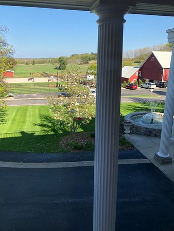 The Inn at Black Star Farms: View from our room of fountain and riding stables