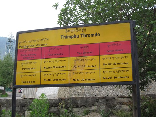 Thimphu Chorten (Memorial Chorten): Parking fee board outside The National Memorial Chhorten, Thimphu, Bhutan