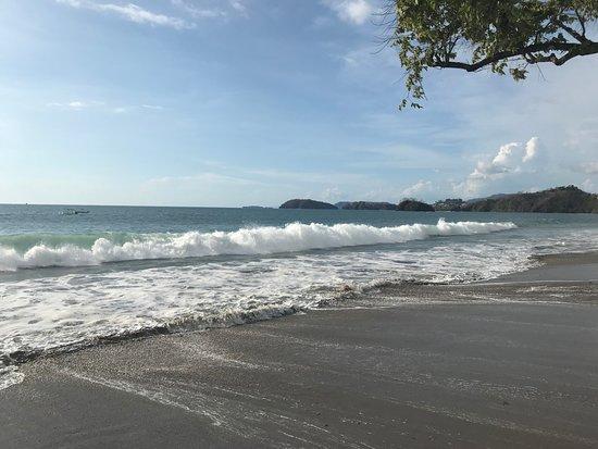 Breaking wave on Playa Brasilito at Indira Bar & Restaurant