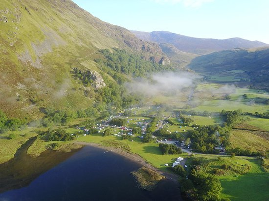 Nant Gwynant, UK: An aerial view showing the campsite between river and lake, below the mountains