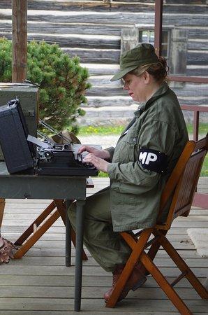 Newburg, WI: A WAC MP typing on a typewriter.