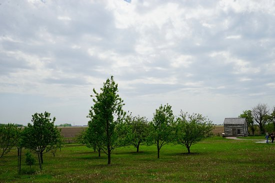 Homestead National Monument of America: A few trees dot the area between the parking lot and the pioneer cabin