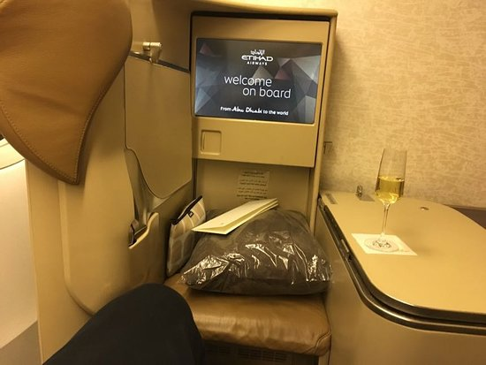 Etihad Airways: Business class facing screen/table. Window seat.