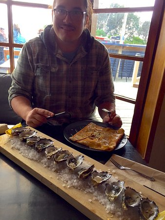 Adventure Bay, أستراليا: My son, tackling the oysters....and a crepe!