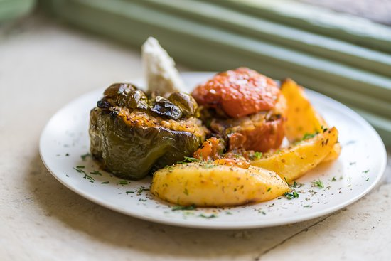 Κάρμα: Gemista tomatoes and peppers stuffed with a delightful mix of rice and herbs, accompanied by ...