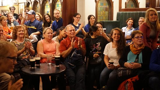 Traditional Irish Musical Pub Crawl: Crowd enjoying Music and Stories