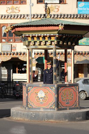 Of Bhutan Divine Hills and Valleys: No traffic lights in the entire kingdom of Bhutan. The police direct traffic in Thimpu.