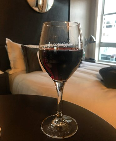 Harbor Court Hotel: Glass of Napa red from happy hour. Third floor room.