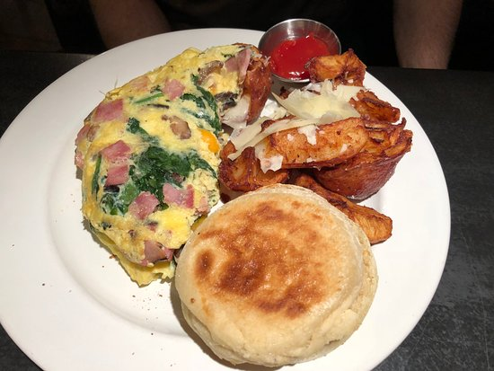 Triumph Grill: Custom Omelet with Potatoes and Muffin