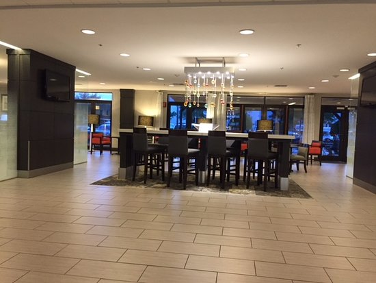 Wingate by Wyndham Dallas/Las Colinas: Lobby breakfast area seating (partial), lots of other options