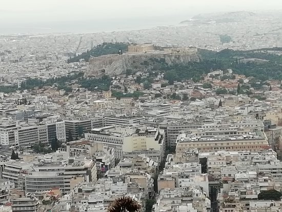 K. Grill Lycabettus: Looking down on the city. The Acropolis and beyond to the sea