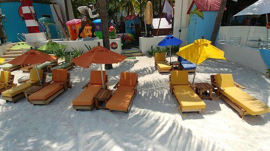Grand Oasis Palm: Kids club beach area with kid friendly chairs