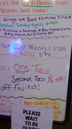 Mooney's Bar and Grill: Specials board at front entrance.