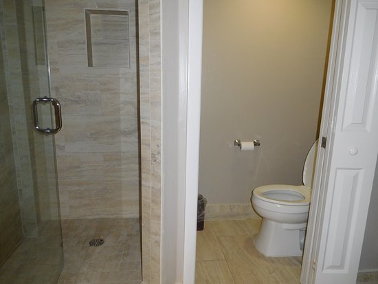 GullWing Beach Resort: Tiny toilet room and shower stall