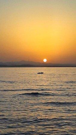 Deep Dark Safari: Some of us fishing at sunset.