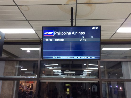 Philippine Airlines (PAL) : Informationstavla angående min flight. Tiden kan ändras på avgångstider.