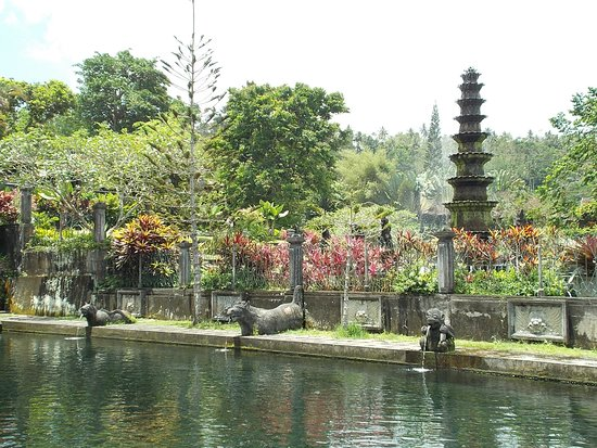 Tirta Gangga: Some sculptures (with water coming out of their mouths) beside one of the big pools