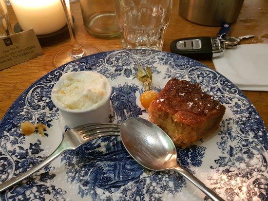 Ewhurst Green, UK: Treacle Tart on the plate [1/2 eaten]