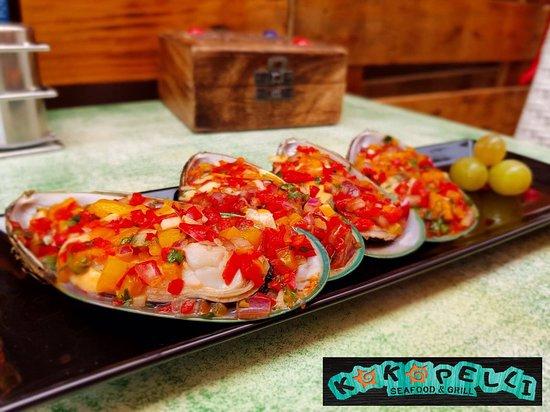 Kokopelli: Green mussels with hot Peruvian sauce