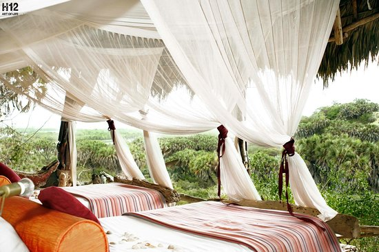 Kau, Kenya: Ozi - the family room with a breathtaking view of Tana Delta. This image is the twin room of Ozi