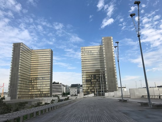 "French National Library (Bibliotheque Nationale de France): Two of the for ""open book"" buildings"
