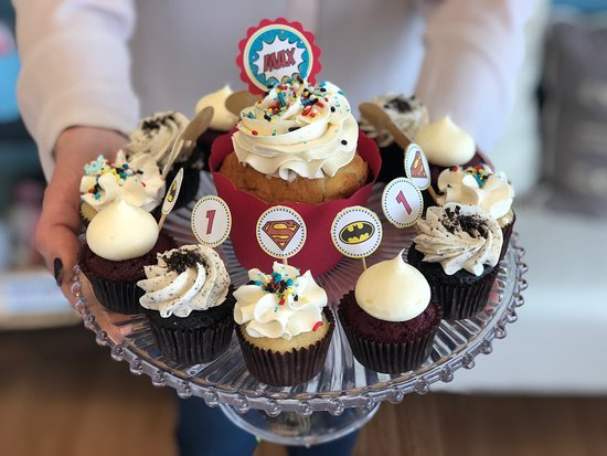 Flavor Cupcakery & Bake Shop: Superhero Themed Muffin Sized Smash Cupcake and Mini Cupcakes by Flavor Cupcakery