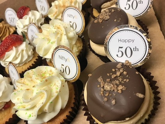 Flavor Cupcakery & Bake Shop: Assorted 50th Birthday Cupcakes with Party Picks by Flavor Cupcakery