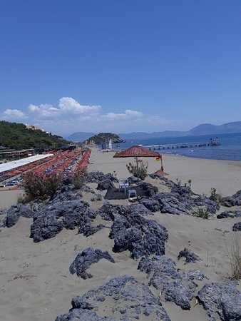 Sarigerme Public Beach: Sand is golden can walk out along way in the sea