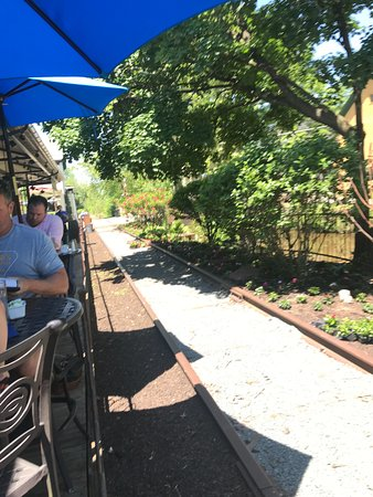 Lambertville Station Restaurant: View of Outside Bar Table and Chair Seating